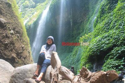 A beautiful girl photo and Madakaripura waterfall