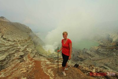 A girl and Ijen crater background view