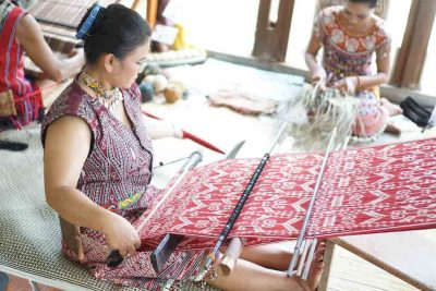 Local people making songket in Palembang